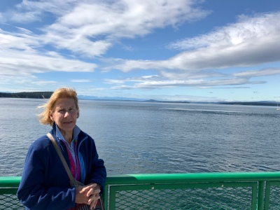 Mom on the ferry. Olympic Mountains in the background.